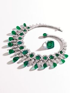 Brooke Astor's Emerald and Diamond Necklace and Ring Set.