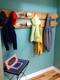 Boat cleats on vintage water skis for coat rack in foyer
