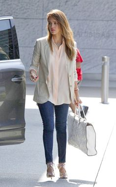 Jessica Alba pairs her pastel peach button-up blouse with a neutral blazer, skinny jeans and bow-adorned sandals.
