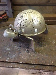 Upcycled Metal turtle colander golf club