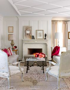 An Alabama Home Gets All Dressed Up  Creating a formal home with a flirtatious attitude, designers Paige Schnell and Doug Davis of Tracery Interiors punched up a neutral color palette with hot pink accents. Flip through these gorgeous room photos for glamorous decorating ideas and inspiration. See all our pink coverage!