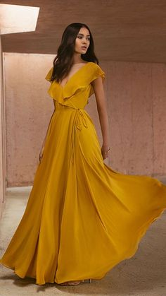 The Faye dress by Jenny Yoo 2019 bridesmaids is a sophisticated & effortless wrap dress with a V neckline & an A line silhouette in our flowy chiffon. This bridal party dress features playful flutter sleeves & a tie closure at the waist. Sexy Dresses, Dress Outfits, Prom Dresses, Formal Dresses, Long Circle Skirt, Yellow Bridesmaid Dresses, Short Sleeve Bridesmaid Dresses, Bridesmaid Dresses With Sleeves, Bridal Party Dresses