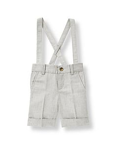 Crafted in a cotton and linen chambray blend, our handsome short is perfect for sunny celebrations. Features front pockets, belt loops and buttoned back pockets. Permanent cuffs and adjustable button suspenders finish the dapper look.