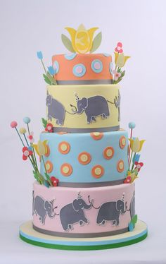 baby shower or child's cake = crown on top and turn it into babar | charm city cakes