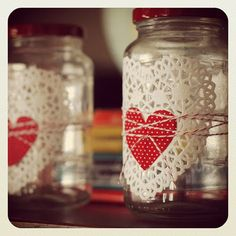 simple valentine jar using fabric hearts, paper doilies and colored baker's twine.