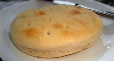 Hallullas are a very popular Chilean bread. They are simple, round, rather plain-looking breads, but they are quite tasty and rich, th. Chilean Bread Recipe, Chilean Recipes, Chilean Food, Latin American Food, Latin Food, My Recipes, Cooking Recipes, Favorite Recipes, Recipies