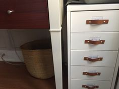 "I used the white (off-white) IKEA Helmer drawer unit, did not attach the wheels that came with it. For the handles, I cut a 5/8"" wide pleather belt"