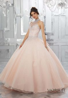 The Perfect Mix and Classic and Modern, this Blush Organza Quinceañera Ball gown Features a Fully Beaded Halter Bodice and Delicately Beaded Ball gown Skirt. Princess Sweet 15 Dress by Valencia | Morilee by Madeline Gardner. Style 60021. Matching Bolero Jacket Included. Colors Available: Blush, Deep Aqua, Hot Pink, White.