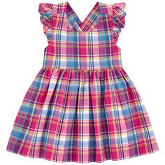 Cotton madras Fine cotton lining 2-piece Sundress Criss-cross straps in the back Flounces on the shoulders Pleats under the waistband Very flared bottom Loose fit Matching knickers Buttons in the back Check patterns - 99,00 €