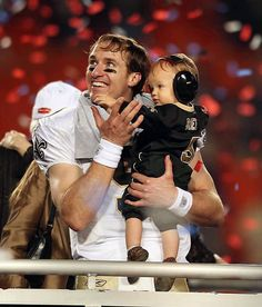 Drew Brees and son with a guaranteed new contract