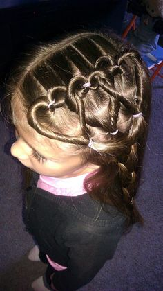 Heart braids. make a pony tail & tie w/ band, put hair back up through middle of pony tail, split hair into two sections, twist each section away from middle, bring together and tie with band - and it sits as a heart <3 (was easy to do one...took a little work to get the three connected, but it was cute when i finished.)