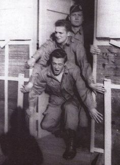 Donald Malarkey, Skip (Warren H. Muc), and Bill Dickerson pretending to jump out of a plane, Camp Toccoa 1942.