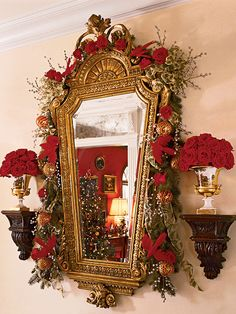 Ready a gilded mirror for Christmas with ropes of garland, red roses, and silver tinsel. (Photo: Tria Giovan)