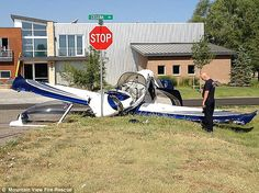 Lucky coincidence? Light aircraft crash lands at bottom of road ...
