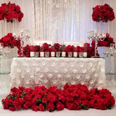 Romantic red and white wedding reception party head table decorations with red rice centerpieces and candles