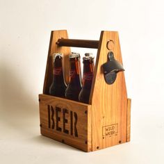 "This handmade box / Beer crate has been created for caring and sharing. It can also be used to store art supplies, bottles, jars apart from it's main use of holding six pint of chilled beer bottles. Measurements: approximately 12"" H x 6"" W 9""L"