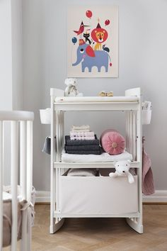 Height adjustable to make diaper changes comfortable. Stokke Care Changing Table in White