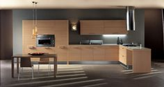 A kitchen solid and essential | A space kitchen staff with strong horizontal solution, thanks to its slatted door that redefines the traditional wooden kitchen with rigorous simplicity. A new concept of kitchen, essential in solid form and in the structure