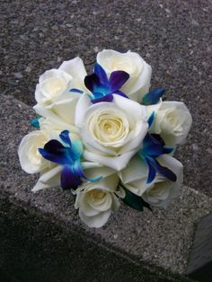 Blue Orchid & White Rose Bouquet  http://www.greenscapedecor.com/galleries/rentals/weddings/assorted-fresh-floral-wedding-bouquets/