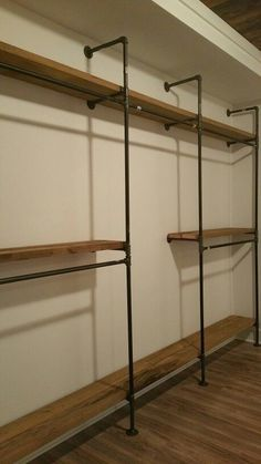 Black iron pipe master closet shelving with tall dress hanging section #olmsteadhomesteads #buildqualitylife