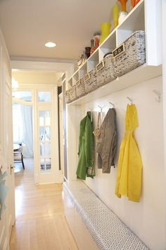 Dwellers without Decorators: Narrow mudroom with sleek, modern white wall length bench and overhead cubbies. Woven ... Cubbies, Mudroom, Foyer Decorating, Hooks, Closet, Storage, Bed, Furniture, Home Decor