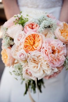 Soft and sweet flower bouquet with the softest pinks and peaches in roses, tulips, stock and Queen Anne's lace