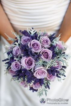 Purple roses, lavender and dusty miller bridal bouquet.