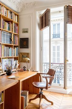 A home office that doubles as a home library sets an academic, well-read tone. This desk space has an artistic, intellectual vibe that's pure Parisian chic.