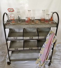 Amazing industrial cart with bins...glass dairy bottles, woohoo!