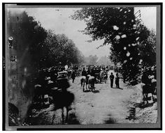 "Soldiers(?) in wagons and mounted on horses during the ""grand review"" of the Union Army, Washington, D.C."
