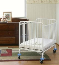 L.A. Baby Deluxe Holiday Folding Metal Crib ,  White  http://www.babystoreshop.com/l-a-baby-deluxe-holiday-folding-metal-crib-white/