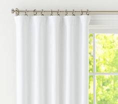 Thinking of these sailcloth canvas curtains for the living room... from Pottery Barn Kids of all places haha