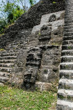 Several of the pyramidal temples at Lamanai, Belize featured large masks on the facade.