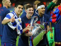 Luis Suarez, Lionel Messi and Neymar pose with the Champions League trophy following Barca...
