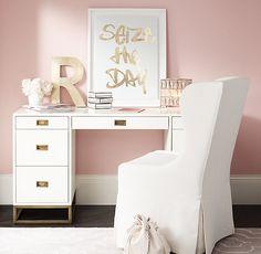 Gold pulls add polish to a crisp white desk