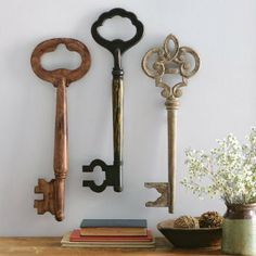 Skeleton keys as wall decor - wonder if these could be DIY'd with wrapping paper rolls, cardboard, and paper mache? Hmmmm...