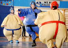 Inflatable sumo suit wrestling fundraiser delights large crowd in Rumford. Picture giant Beanie Baby sumo wrestlers bouncing around a mat and you'll get a good idea of Saturday night's St. Patrick's Day Sumo Wrestling Throwdown Showdown.  The debut event at Mountain Valley High School pitted community and business members and students against each other for rollicking laughs in the fundraiser for the Greater Rumford Community Center and its programs.