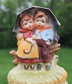 Vintage Sankyo Hummel Style Music Box Raindrops Keep Fallin on My Head is such a sweet figurine of a young boy and girl sharing an umbrella in the style of Hummel.     Excellent condition, the piece i