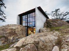 Rock house. Black double height windows.