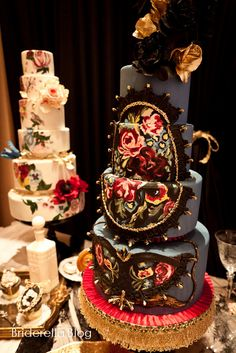 Weddings Cakes Luxurious Black Wedding Cake With Floral Rug Motif And Gold Flowers Topper
