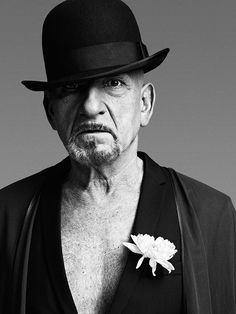 Ben Kingsley. Mature, self-confident, and sexy style. And I love men that wear flowers in their lapel!