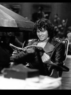 ♡♥Jim Morrison smiles as he likes what he read - click on pic to see a larger pic♥♡