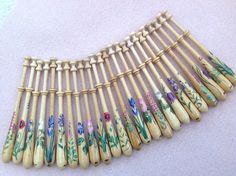 Bayeux lace bobbins with painted flowers