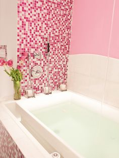 Stunning modern bath tub with PINK glitter glass tile! A girl's dream, a pink bathroom!