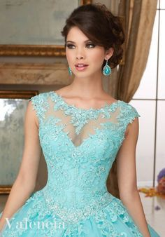 Full of amazing details, you'll look like a beautiful Princess wearing Mori Lee Mori Lee Valencia Quinceanera Dress Style 60006 at your Sweet 15 party. Made out of lace and tulle, this ball gown featu