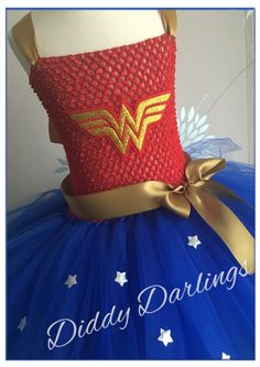 Wonder Woman Tutu Dress. Beautiful & lovingly handmade.  All characters and colours available Price varies on size, starting from £25.  Please message us for more info.  Find us on Facebook www.facebook.com/DiddyDarlings1 or our website www.diddydarlings.co.uk
