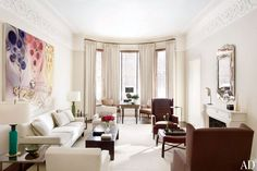 The neutral parlor of a Boston townhouse receives a splash of color from a Sophie von Hellermann painting