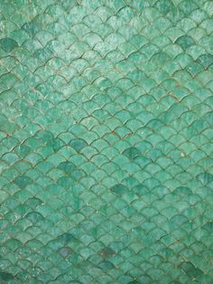 "The pattern is a ""fish scale"" and it indeed shimmers. I don't know if you can tell but this is a fountain. So pretty and effervescent! Mermaid Tile, Mermaid Bathroom, Mermaid Scales, Fish Scale Tile, Moroccan Tiles, Moroccan Decor, Tiles Texture, Mosaic Tiles, Glass Tiles"