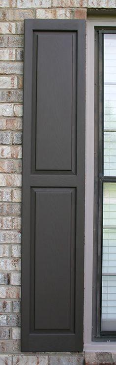 Vinyl shutter repainted in 2013 renewing the dark brown paint color.
