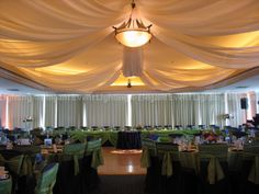Love this ivory ceiling draping design!